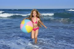 Beach little girl colorful ball playing Stock Image