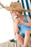Beach - Little girl on deck-chair with ice-cream Royalty Free Stock Image