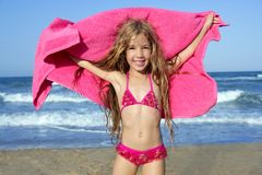 Beach little girl playing pink towel and wind Stock Photography