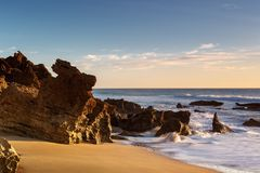 Rock formations on the shore of the beach stock photos