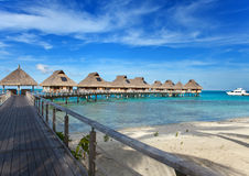 Beach and lodges over the sea Royalty Free Stock Photos