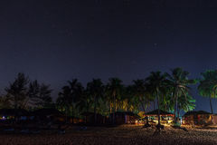 The beach lodges under the star sky. Stock Image