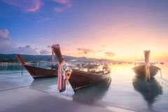 Beach and long tail boats on Phi Phi Island. Sunrise view of tropical beach and long tail boats on Phi Phi Island, Krabi province, Thailand Stock Photography