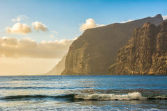 Beach in Los Gigantes with high cliffs on the sunset. Tenerife, Canary Islands. Royalty Free Stock Images