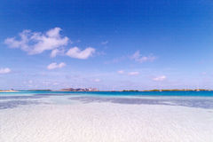 Blue sky over white sandy beach Stock Photo