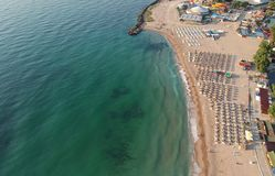 The picture taken from the height. a beach with lots of umbrellas. Waiting for tourists on the seashore stock photo
