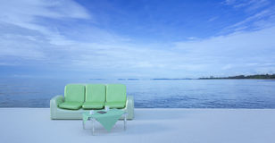 Beach lounge and balconies with sofa and seascape in summer seas Royalty Free Stock Photos
