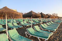 Beach lounge chair and beach umbrella at lonely sandy beach Stock Photography