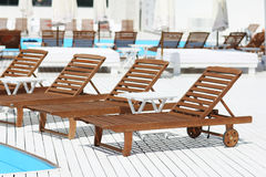 Beach lounge chair near the pool Stock Images