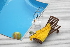 Beach lounge chair near the pool Royalty Free Stock Image