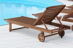 Beach lounge chair near the pool Stock Photos