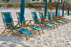 Beach lounge chairs Stock Images