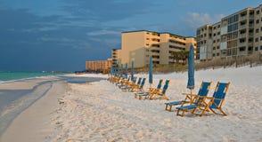 Beach lounge chairs Stock Photo