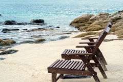 Beach lounge chairs on the beach in the morning. vacation time.beach holiday.beach travel.summer time stock images