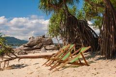 Beach lounge chairs on sandy beach Royalty Free Stock Photo