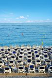 Beach lounge chairs by the sea. Stock Photos
