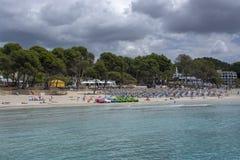 Beach lounge chairs toy boats Paguera Mallorca royalty free stock photo