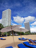 Beach lounge chairs and umbrellas stock photography