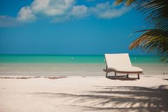 Beach lounger on the exotic resort on white sand Stock Photo