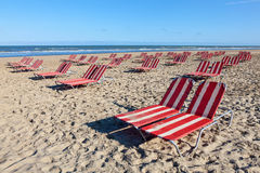 Beach lounger in Holland. Red and white beach lounger on the sandy beach in North Holland, Netherlands stock photography