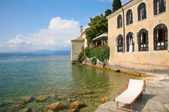 Beach lounger at Lake Garda in Italy Royalty Free Stock Photos