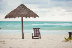 Beach lounger and umbrella on the exotic resort in Stock Images