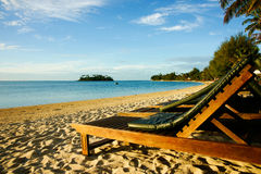 Beach loungers. Beach loungers at a resort await patrons royalty free stock image