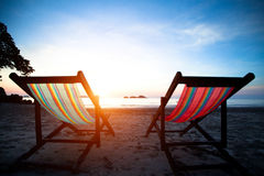 Beach loungers on the deserted coast sea Stock Photography