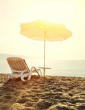Beach loungers at sunrise Stock Photography