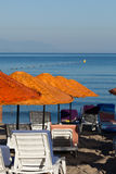 Beach loungers and umbrellas. On the sea Royalty Free Stock Photos