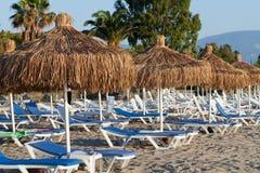 Beach loungers and umbrellas. On the sea Stock Photos