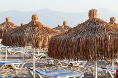 Beach loungers and umbrellas. On the sea Royalty Free Stock Photography