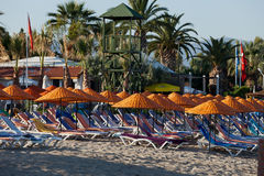 Beach loungers and umbrellas. On the sea Royalty Free Stock Photo