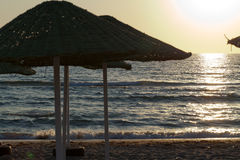Beach loungers and umbrellas. On the sea Stock Images