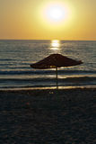 Beach loungers and umbrellas. On the sea Stock Photography