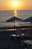Beach loungers and umbrellas. On the sea Royalty Free Stock Images