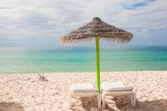 Beach loungers and umbrellas on the exotic resort. At desert coast. See my other works in portfolio Royalty Free Stock Image