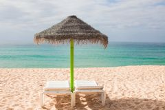 Beach loungers and umbrellas on the exotic resort Royalty Free Stock Image