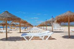 Beach loungers and umbrellas on the sea. Portugal. Vila Moura Stock Images