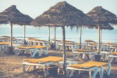 Beach loungers and umbrellas on the sea. Main beach in Agadir ci. Ty located on the shore of the Atlantic Ocean.Morocco Royalty Free Stock Images