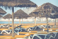 Beach loungers and umbrellas on the sea. Main beach in Agadir ci. Ty located on the shore of the Atlantic Ocean.Morocco Royalty Free Stock Image