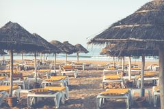 Beach loungers and umbrellas on the sea. Main beach in Agadir ci. Ty located on the shore of the Atlantic Ocean.Morocco Royalty Free Stock Photography