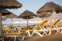 Beach loungers and umbrellas on the sea. Main beach in Agadir ci. Ty located on the shore of the Atlantic Ocean.Morocco Royalty Free Stock Photo