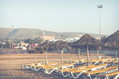 Beach loungers and umbrellas on the sea. Main beach in Agadir ci. Ty located on the shore of the Atlantic Ocean.Morocco Royalty Free Stock Photos