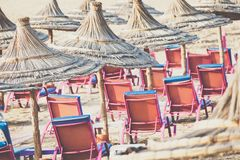 Beach loungers and umbrellas on the sea. Main beach in Agadir ci. Ty located on the shore of the Atlantic Ocean.Morocco Stock Image