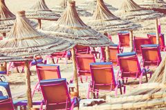 Beach loungers and umbrellas on the sea. Main beach in Agadir ci. Ty located on the shore of the Atlantic Ocean.Morocco Stock Images