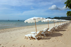Beach with loungers and umbrellas. White Sandy Beach with Loungers and Umbrellas in Koh Samui, Thailand Stock Photo