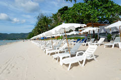 Beach with loungers and umbrellas Stock Photos