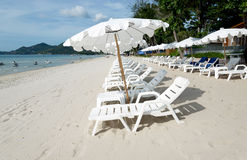 Beach with loungers and umbrellas Stock Images