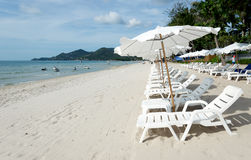 Beach with loungers and umbrellas. White Sandy Beach with Loungers and Umbrellas in Koh Samui, Thailand Royalty Free Stock Photography